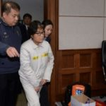 Choi Soon-sil arrives for her first court hearing in Seoul